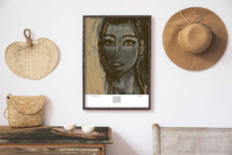 Picture of a wooden cabinet and a framed art print on the wall