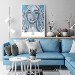 Picture of a living room with a blue sofa and a blue framed art print
