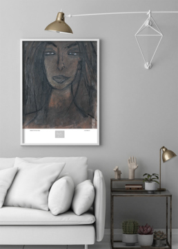 Picture of a light colored sofa and side table with a framed art print on the wall