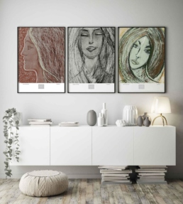 Picture of a living room cabinetry with three framed art print on the wall