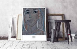 Picture of a framed art print on the floor with a stool and some empty frames