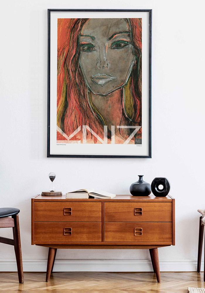 Picture of a living room cabinet with a framed art print on the wall