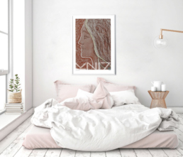 Picture of a bedroom with a framed art print on the wall