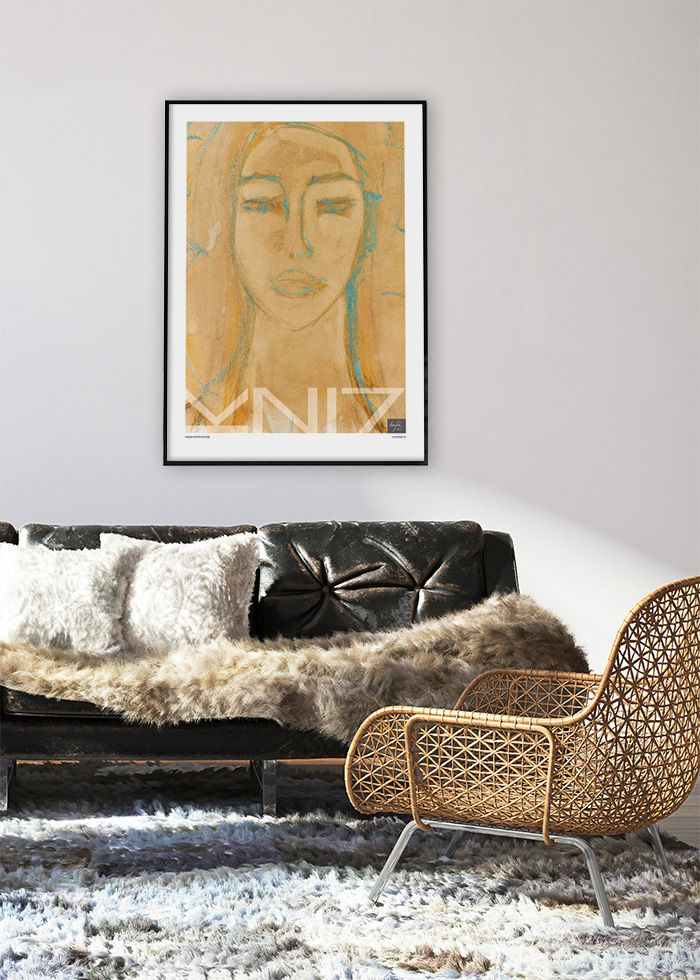 Picture of a living room with black leather sofa and a wicker chair and a framed large yellow art print on the wall