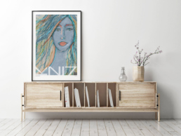 Picture of a living room cabinet with a large framed art print on top