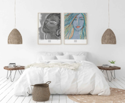 Picture of a bedroom with framed bw and colorful art prints on the wall