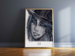 Picture of a framed art print against a bluish grey wall