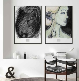 Picture of two framed art prints on a white interior setting