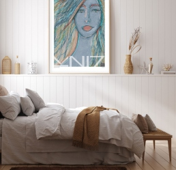 Portrait art print in a light colored bedroom wall