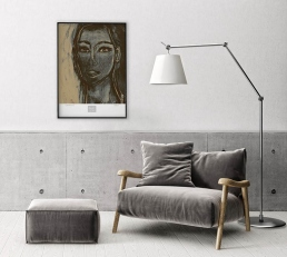 Clay color arm chair and Artemide lamp with portrait art poster on the wall