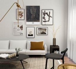 Modern living room with several art prints on the wall