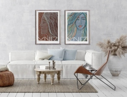 Modern white sofa and a leather chair with portrait art prints on the wall
